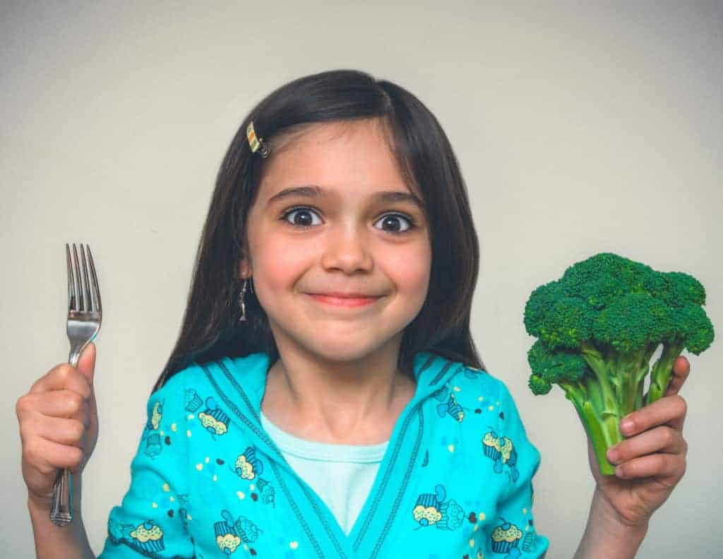 Learn two surprisingly simple tricks that will get your kids to eat vegetables - willingly!