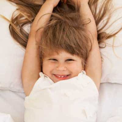 Sleep problems are tough, particularly if you're dealign with the 18 month sleep regression, new nighttime fears, or an energized toddler who refuses to go along with bedtime as usual. Here are helpful solutions to common sleep struggles including sleep regressions and tips to get your child's sleep back on track.