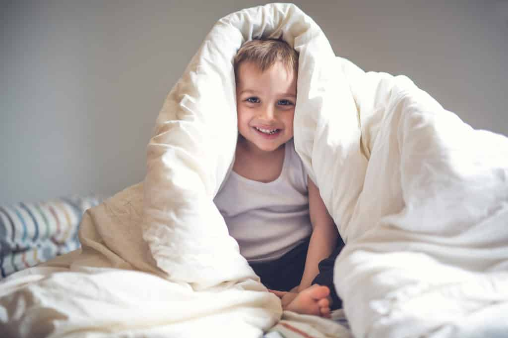 9 tried-and-true strategies to make bedtime easier with kids. Bedtime for kids doesn't have to be stressful. Help your kids go to bed without a battle. 9 Ways to Make bedtime easier.