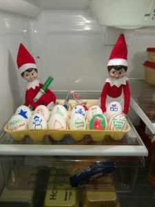 elf on the shelf caught coloring eggs