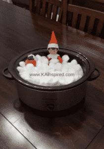 elf on the shelf taking a bath