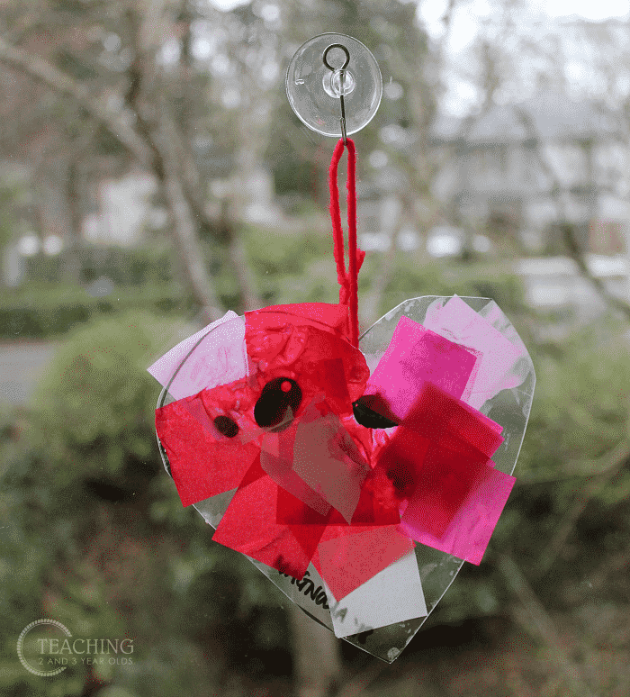 plastic heart suncatcher valentines day craft for toddlers