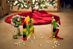 snowball fight with a toy and elf on the shelf