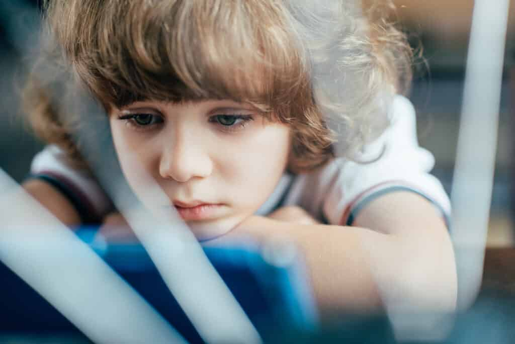 The harmful effects of too much screen time for kids & the unexpected effects of daily electronic use to the physical, mental & emotional health of kids.