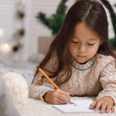 Santa Claus' real mailing address and how to send a letter to Santa, receive a letter from Santa and have your letter postmarked from the North Pole.